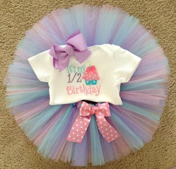 It's my half birthday cupcake tutu outfit. light pink, aqua, and lavender tutu  6 month pictures, half birthday tutu