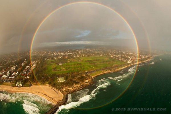Full circle rainbow was captured over Cottesloe Beach near Perth, Australia in 2013 by Colin Leonhardt of Birdseye View Photography.  He was in a helicopter flying between a setting sun and a downpour.