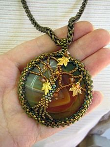 FROM: Anna Braginskaya. This link takes you to Anna's blog where you will find pics for all types of beautiful beaded creations. The site is not written in English.