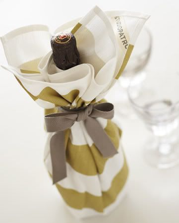 hostess gift: bottle of wine wrapped in a cute dish towel
