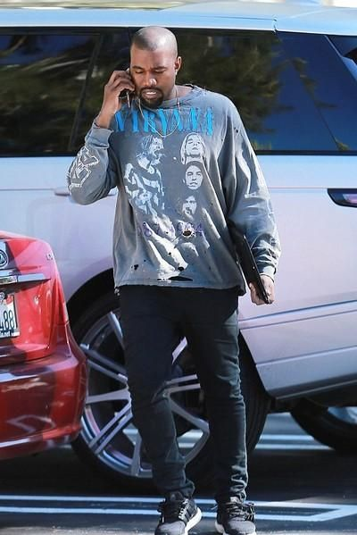 Kanye West wearing Adidas Ultra Boost Sneakers and Acne Ace Cash Jeans