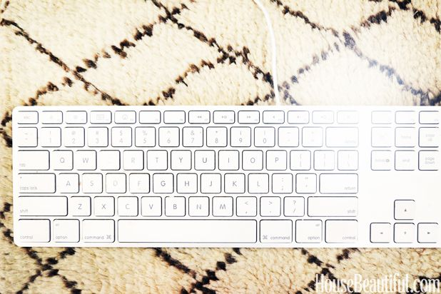 I love leather desk blotters, but this Moroccan rug sample keeps my palms comfy and keyboard secure just as well.  How To Make Your Cubicle Feel Like Home  - HouseBeautiful.com