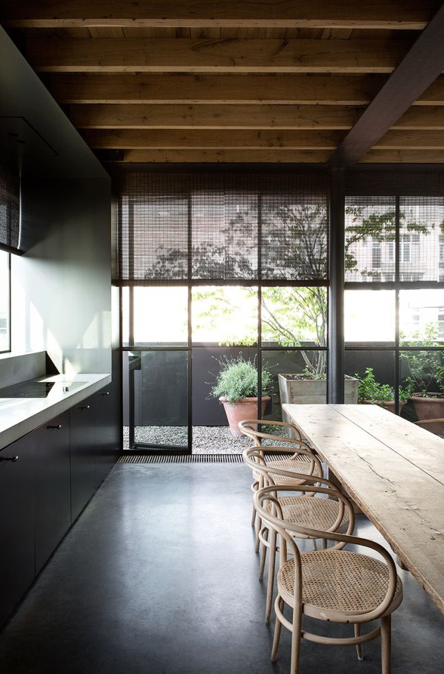 Minimalist home, outdoor feel, nature, industrial, clean lines. Grey palette, wooden beams, glass.