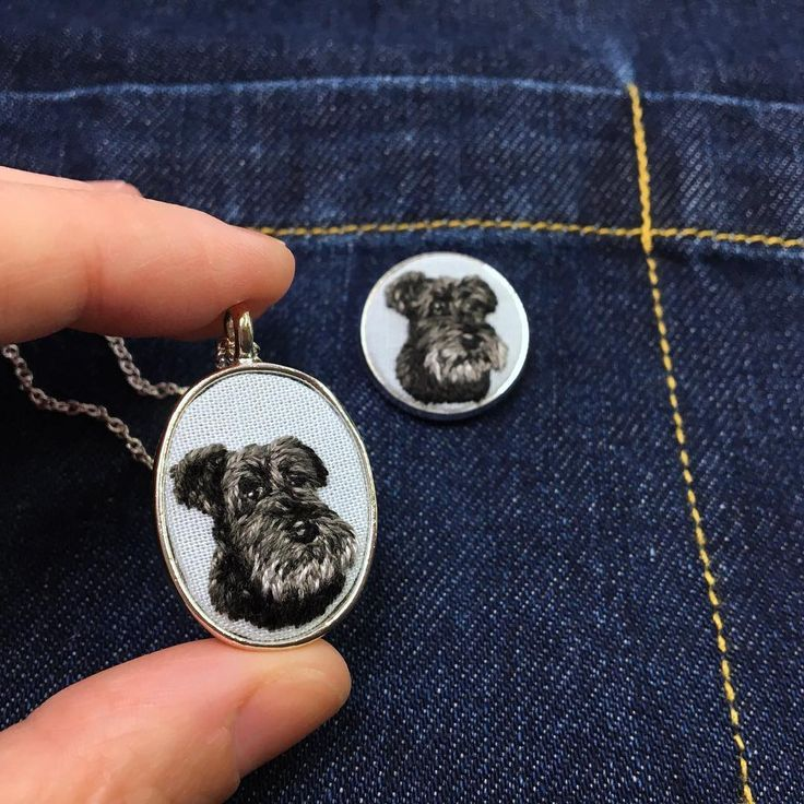 This schnauzer was made as a pendant and matching pin in silver. The pup was stitched on the cloud colored background which is a subtle…