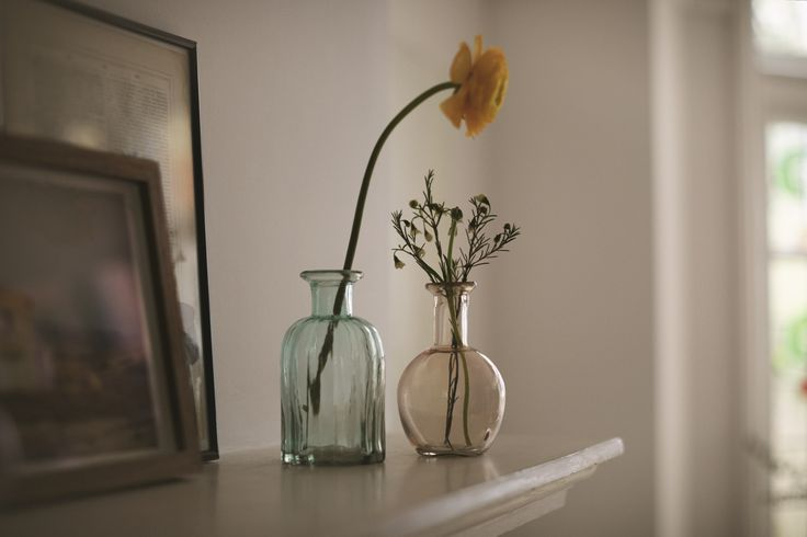 We love how these tiny vases add an easy feminine touch.