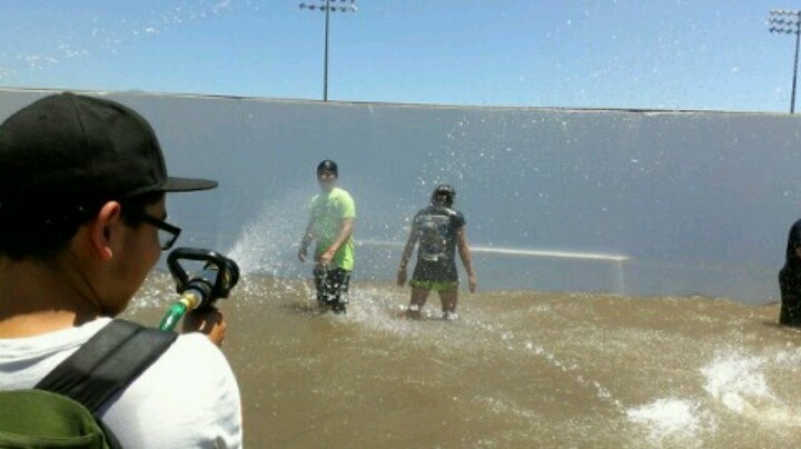 Alex getting us wet with the fire hose @ hero rush 2012. Pomona fair grounds.
