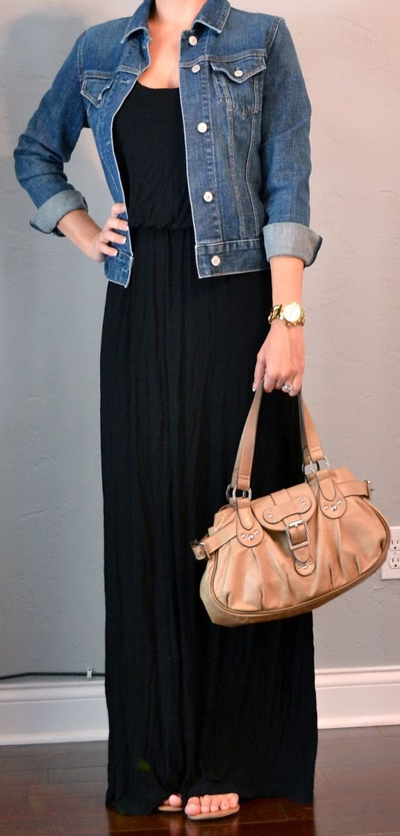 Black maxi dress casually paired with denim jacket