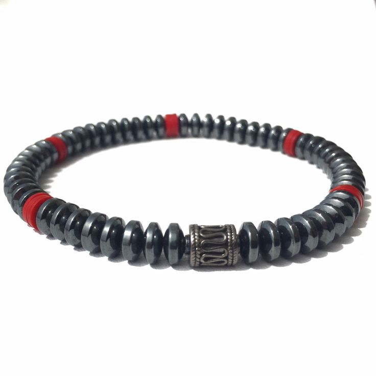 Hematite is a stone that is most commonly and most strongly used to ground and for protection. Great for increasing intuition. Ornate with African recycled red lp's and Sterling Silver accent bead and