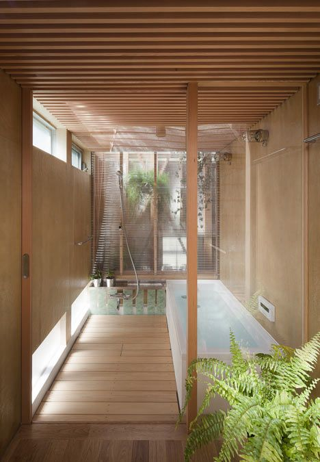 Bathroom - house by Japanese architects a.a.+H has two roofs and four more tiny houses inside