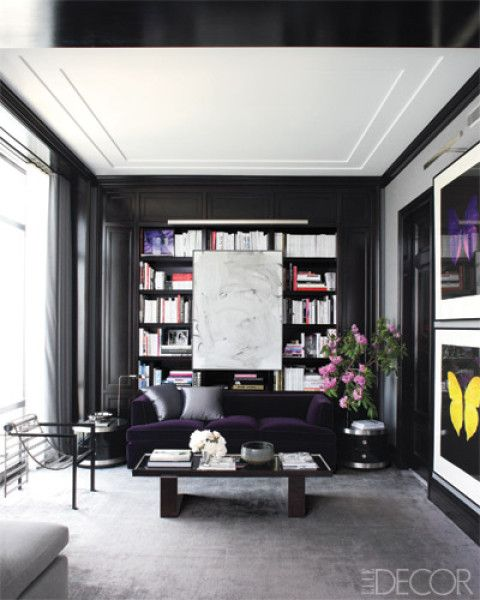 The sitting area of the master bedroom in Drew Aaron and Hana Soukupova's New York City apartment includes a painting by Christopher Wool and a metal-and-acrylic armchair by Paolo Pallucco and Mireille Rivier.     Photographer: William Abranowicz   Designer: Mark Cunningham   Homeowner: Drew Aaron and Hana Soukupova   Issue: October 2010
