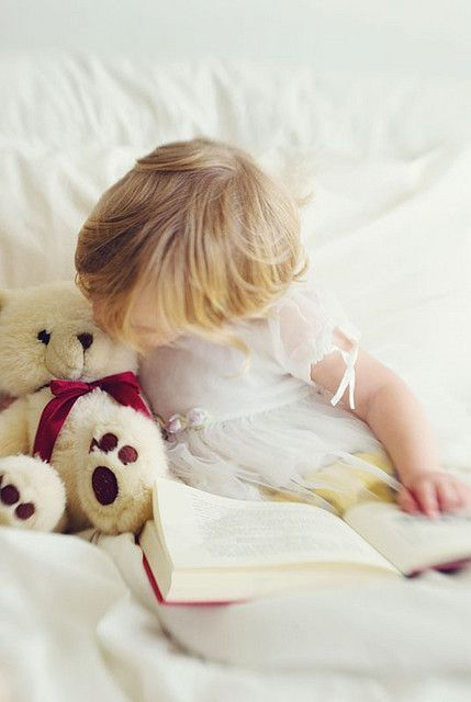 Story time for her teddy bear..