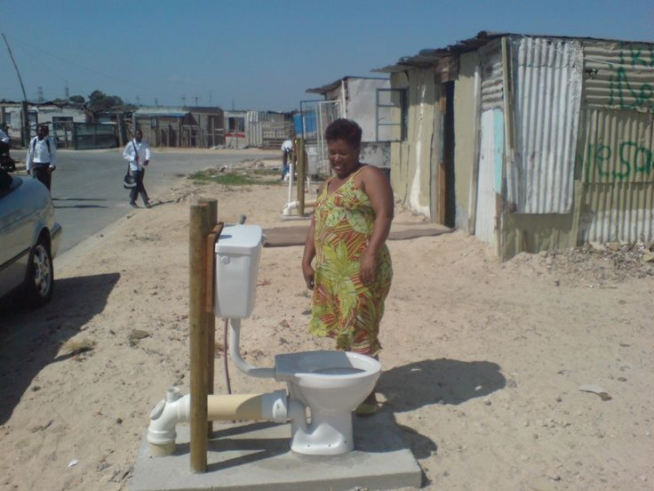 """Loo with a view"""" These toilets were installed in Khayelitsha in Cape Town without enclosures with the agreement of the community (and ward councillor) – claiming that the community agreed to enclose their own toilets if the City built one toilet per household instead of the planned one per five households."""