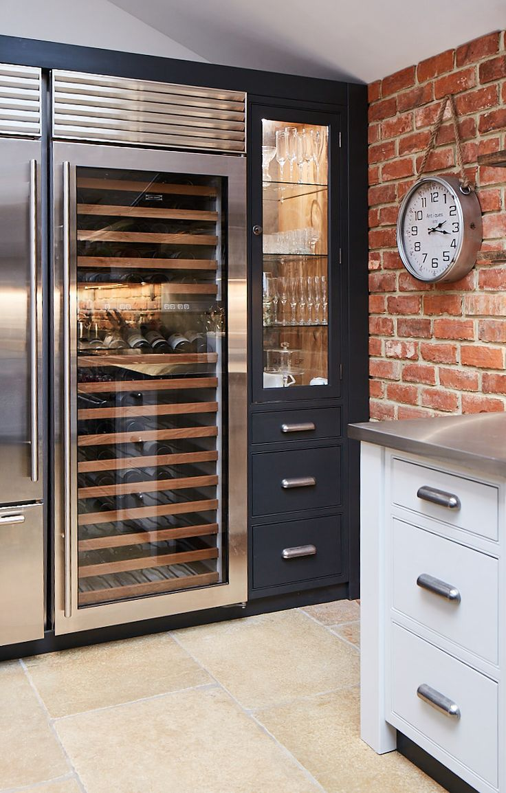 Sleek wine cooler from SubZero available from bespoke kitchen company The Main Company. http://themaincompany.co.uk/p/Industrial