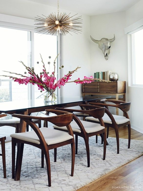 my breakfast table chairs  Exclusive: Tour Claire Thomas' Mod House on Stilts via @domainehome // Organic Modernism table and brass urchin chandelier.