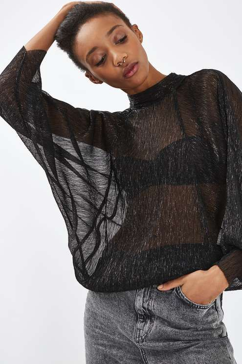 The essential shape of the season, the batwing sleeve is having a moment. We love the style on this metallic crinkle top in a sultry sheer fabric, with a pretty tie back detail. Wear over a bralette with high waisted jeans for an effortless day-to-night look. #Topshop
