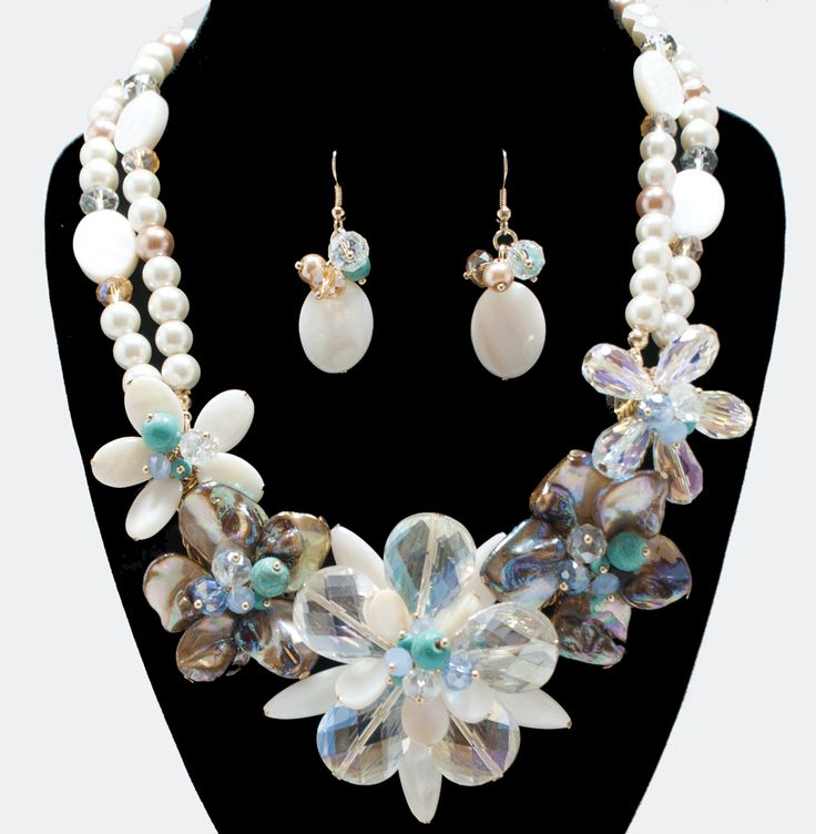 http://kareliafj.tictail.com/product/flower-shell-with-pearl-necklace-earring-set