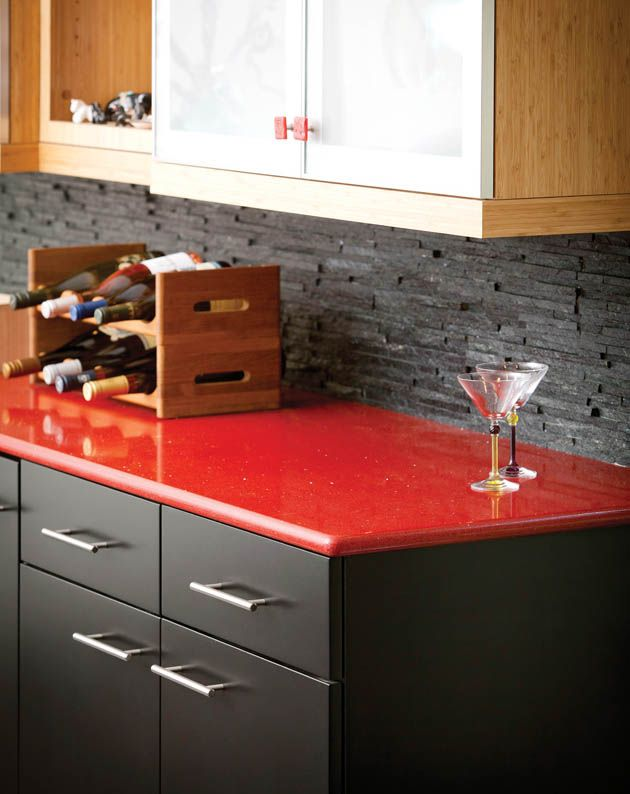 kitchen bar with grey cabinets and red quartz countertops