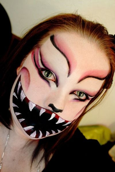 Cool Chesire cat makeup!  The darker side of Wonderland..    The best part of this makeup is the mouth. She got the black on so good. The whole look is Good. I like how a lot of attention was paid to hiding the mouth.