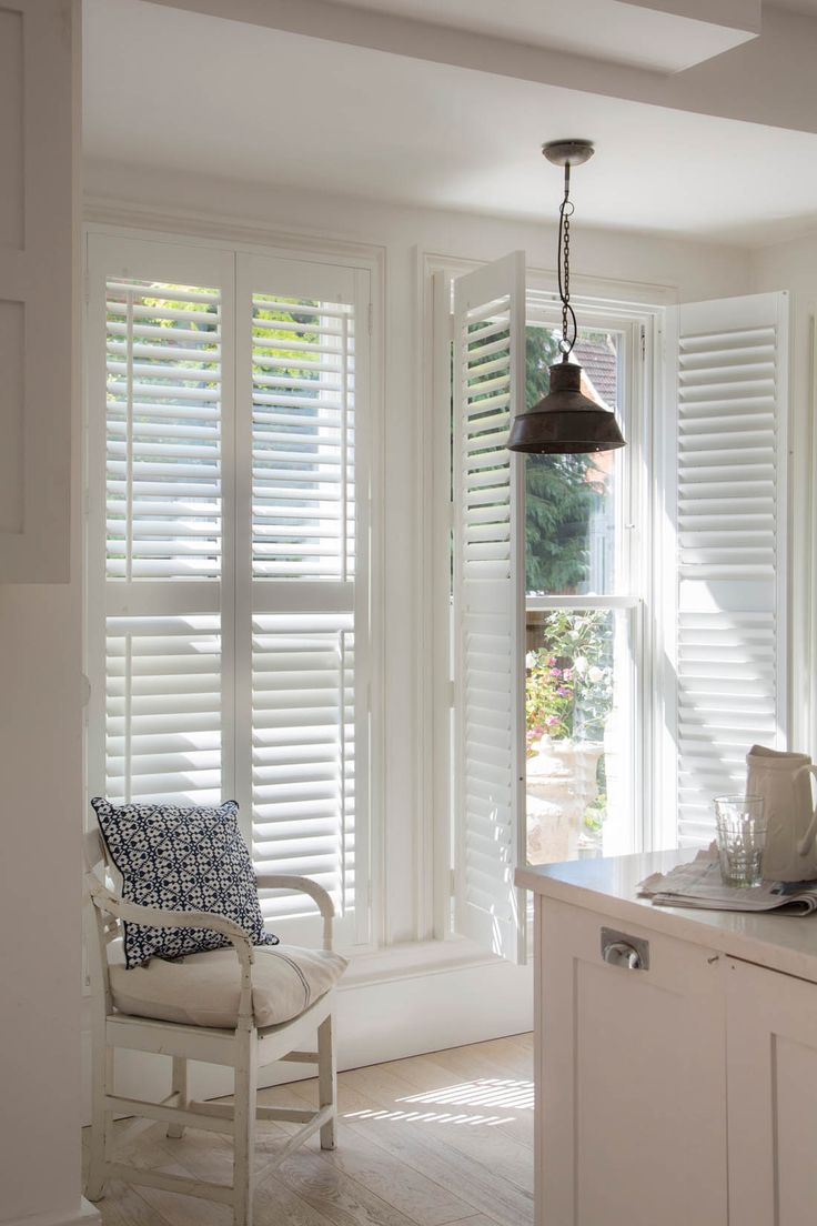 Wooden plantation style shutters in kitchen by Luxaflex | Available from Solar Sunshades