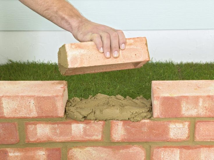 DIY Network shows you how to lay a brick garden wall in your yard.