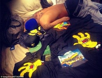 Rihanna was Unapologetic about posting an image of Chris Brown topless on a bed surrounded by The Simpsons memorabilia