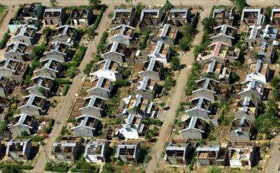 An aerial view of Maliana, a large town in southwest   East Timor October 5, shows a group of houses   that have been damaged by suspected pro-Jakarta militia   in recent weeks.
