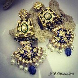 Indian Wedding Jewelry - Polki Kundan Earrings   WedMeGood  Beautiful Polki Earrings with Blue and Green Meenakari Work. Like Them? Visit us at wedmegood.com  #wedmegood #polki #meenakari