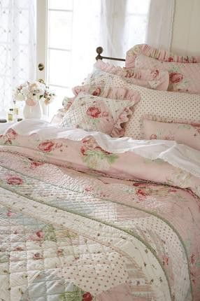 Quilting, wrought iron bed, cabbage rose bedding, the coloring and ruffles all come together to create that cozy and feminine cottage style.