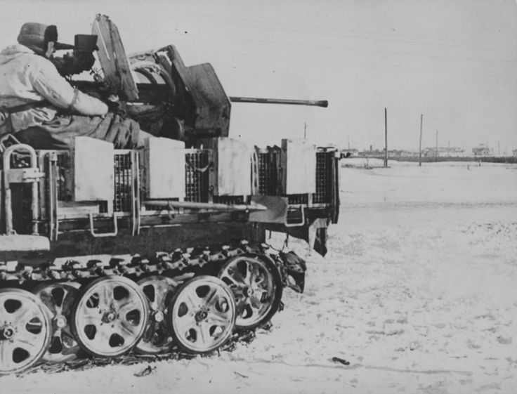 German ZSU Sd.Kfz.10 / 4 in a snowy field on the outskirts of Soviet city