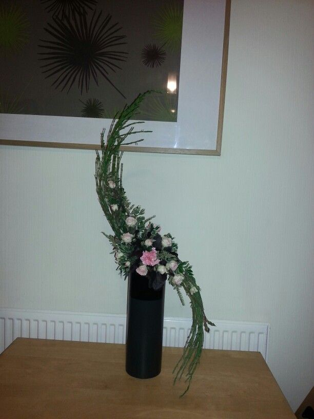 Hogarth Curve Using Spray Roses Spray Carnations , Broom For Structure And  Heuchera Leaves For Definition