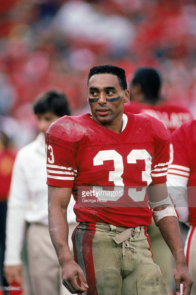 Running back Roger Craig #33 of the San Francisco 49ers looks on as he stands on…