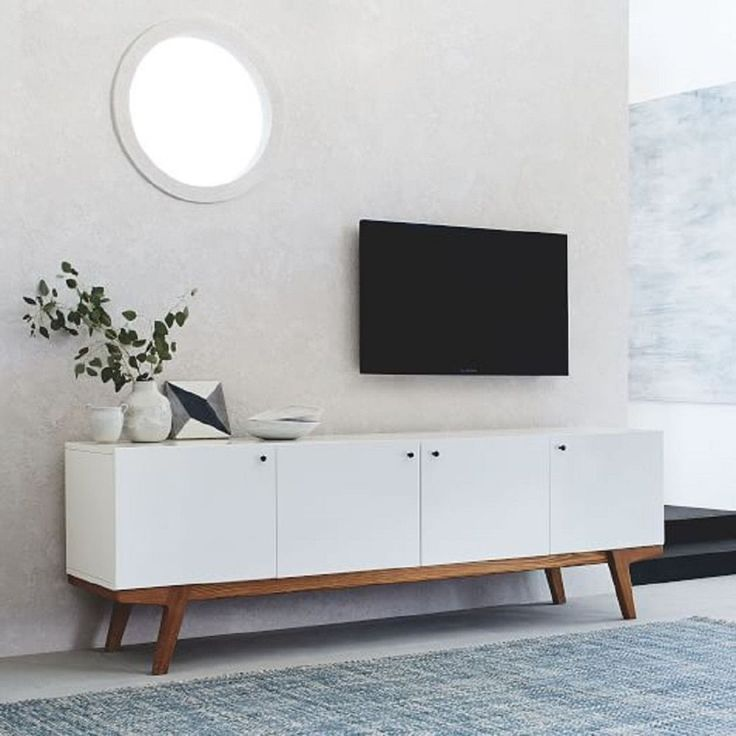 Inspired by Scandinavian modernism, our 203cm Modern Media Console pairs a sleek body with a pecan-finished frame and beautifully angled legs. The result? An oversized storage piece that's easy on the eyes and fits in with an eclectic mix of furniture.