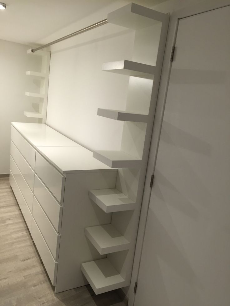 "Dressing room with three Ikea furniture ""malm"", two Ikea furniture ""lack"" and one"