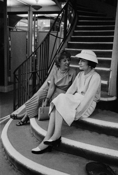Coco Chanel captured by Mark Shaw for LIFE in 1957. Chanel is seen on the stairs of her Paris atelier with a female confidante