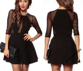 nie ma to jak mała czarna ;) http://feegle.pl/149434-czarna-sukienka