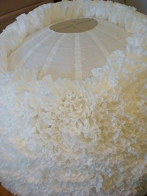 maybe one per table, made of coffee filters glued onto lanterns.  Could dye pink first.