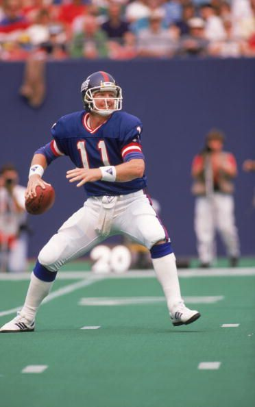 Quarterback Phil Simms of the New York Giants against the San Francisco 49ers…
