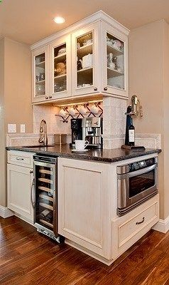 corner counter. love the coffee bar and wine wrack: breakfast center idea