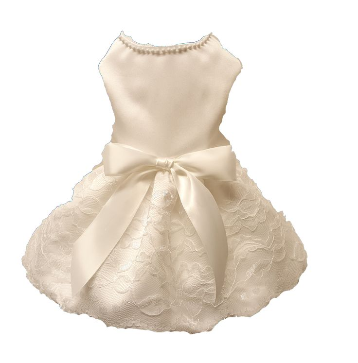 Handmade dog dress white satin fabric with lace overlay skirt. Embellished with pearls at neckline and white satin bow at waist. Garment lined to insure comfort, velcro at neck and chest for easy adju