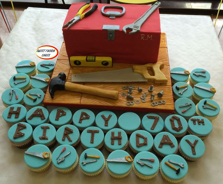 Tool box cake with edible tools and matching cupcakes