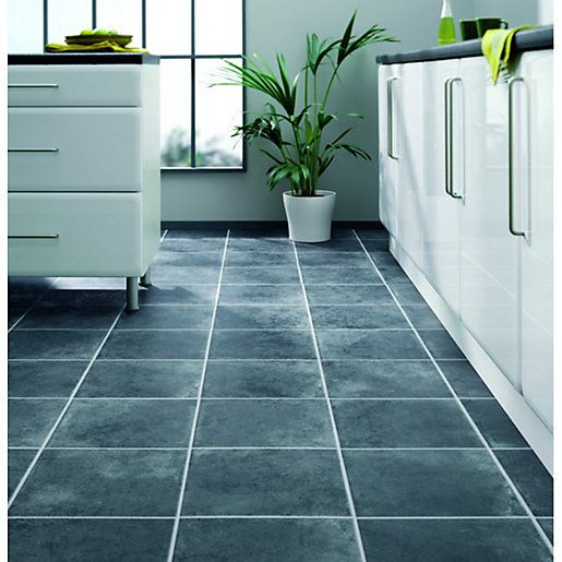 Anthracite laminate flooring from Wickes creates an authentic stone appearance featuring a 4-tile pattern.
