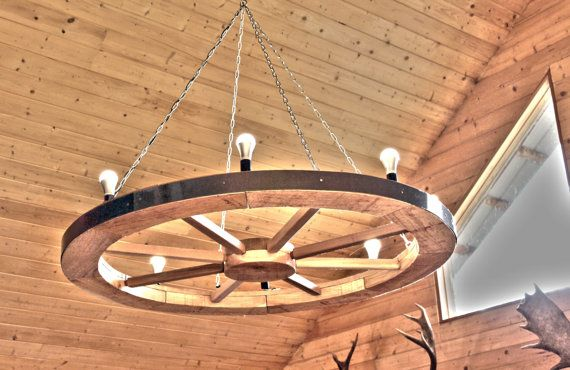 Custom Wagon Wheel chandelier. by RusticWestCoast on Etsy  Looking to add that rustic feel to your living space? These are custom created wagon wheel chandeliers, where the size and specifications are completely up to you!