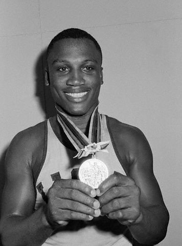 Boxing legend Joe Frazier with the gold medal he earned at the Olympic Games in Tokyo in October 1964.