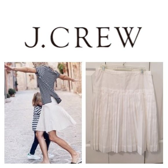 J CREW white pleated skirt Beautiful classic and chic cotton fitted then flare with pleats. It has side zipper and lined . J. Crew Skirts