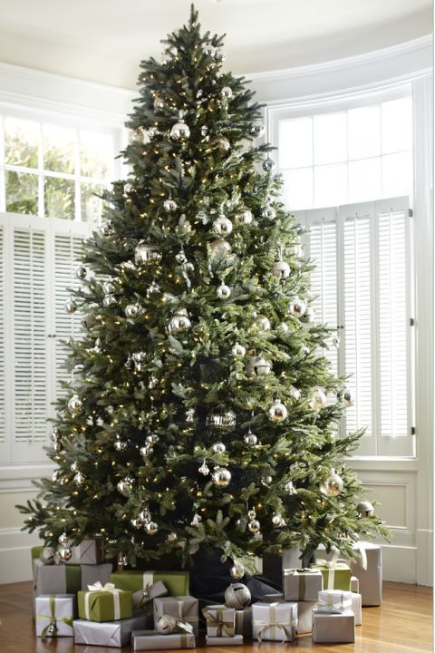 "Converts from living trees will love this take on a Fraser fir. The ""best Christmas tree species in nature"" looks equally stunning in artificial form with silvery-green needles. (starting at $459, BalsamHill.com)"