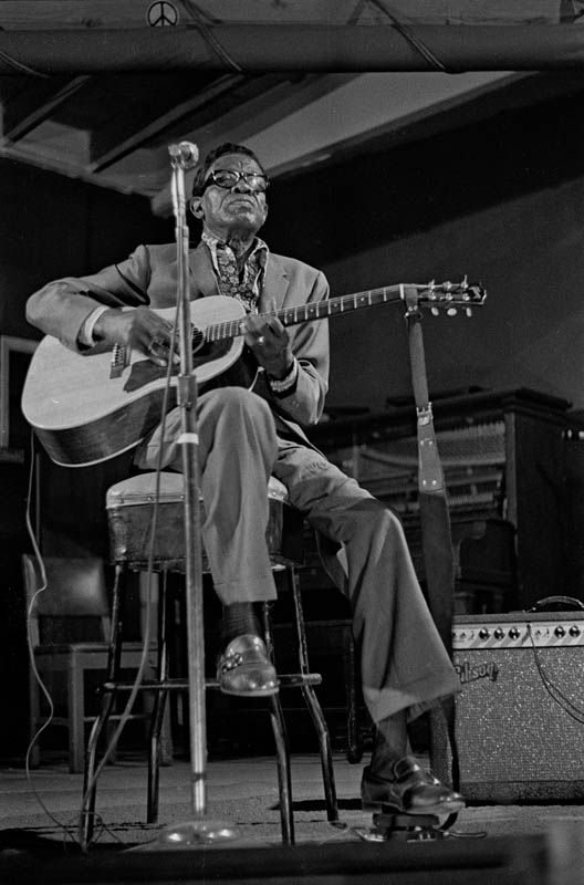 "Lightnin Hopkins Ash Grove Here's a photo of Texas bluesman Sam ""Lightnin'"" Hopkins, performing at the Ash Grove in Los Angeles. It has some historic value in that the Ash Grove burned to the ground in 1973 and Hopkins died in 1982. His style and music, however, live on."