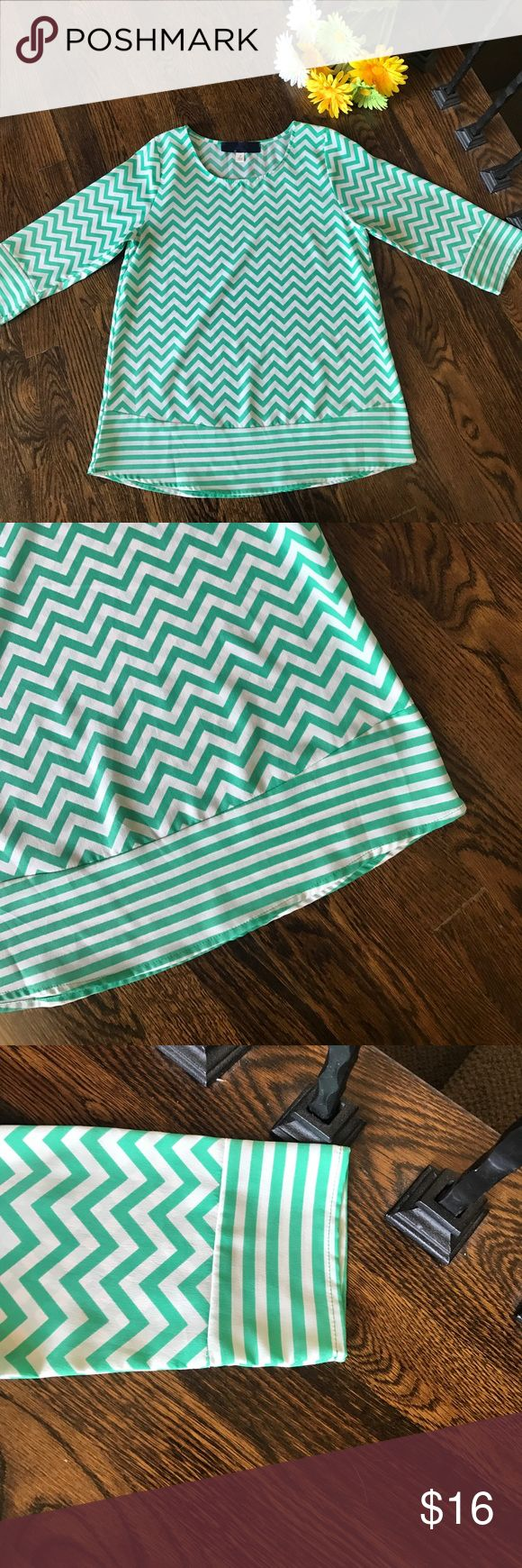 Teal & White Chevron Top, Sz S Super cute teal and white top purchased from a local boutique. Three quarter sleeves. Lightweight fabric. NEVER needs ironed! Great for travel and summer at the office. Tops