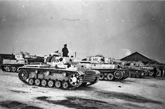 Panzer III Ausf. L's and Panzer. VI Ausf. E (Tiger) assembled after unloading in Poltawa, February 1943. The Tigers are the early-production variant.
