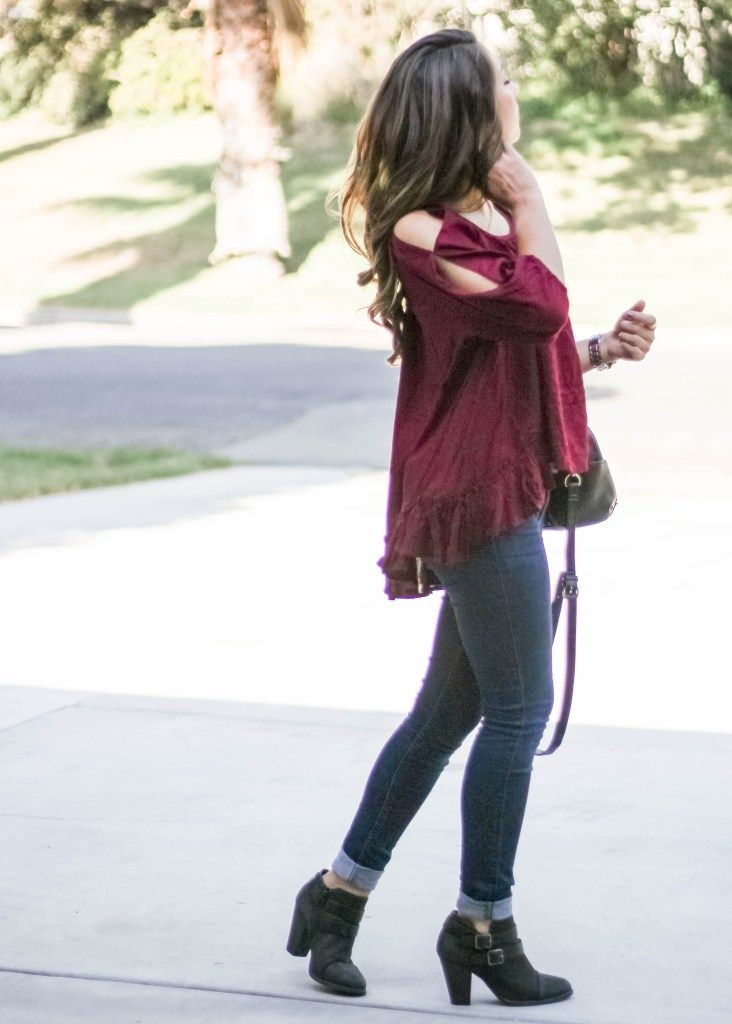Moo's Musing Fall Outfit Red Maroon Arm Cut Out High Low Top with Jeans and LC Lauren Conrad Boots with Target Purse Outfit Inspiration