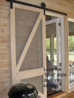 Barn-style Screen door. Cool and easy to make...could put it on hinges if the space is to small for a sliding door.